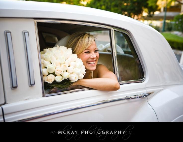 bride and wedding car